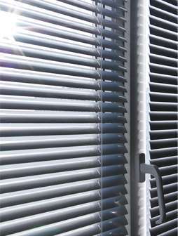 Clean sparkling white window blinds, cleaned with ultrasonic blind cleaning.