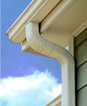 Gutter of a home. Specialty cleaning services include gutter cleaning services, scratched glass repair, and blind cleaning.