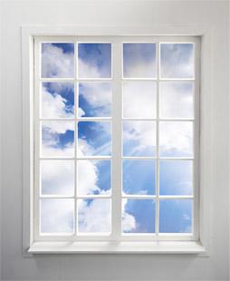 Sunny, cumulus cloud sky viewed through glistening windows. Residential window cleaning by Modern Window.