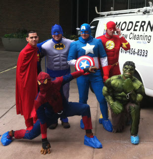 Modern Window Cleaning Crew dressed in superhero uniforms