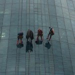 High rise window cleaners dressed as Superheroes rappel down the side of the hospital to surprise children on halloween