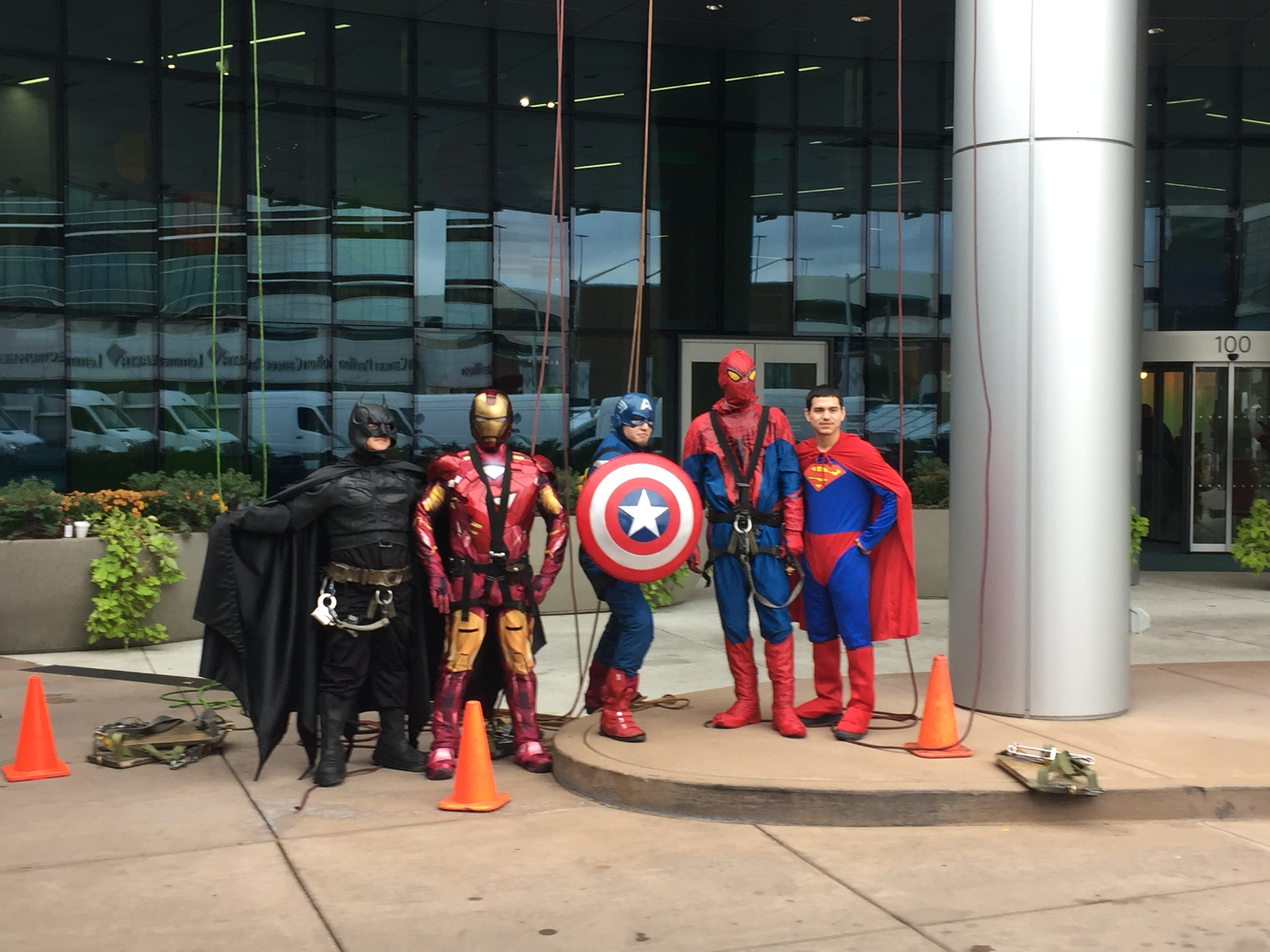 High rise window cleaners dressed up as superheroes to suprise children on Halloween at the hospital