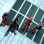Superheroes rappel down building during Helen Devos Children's Hospital Halloween Party