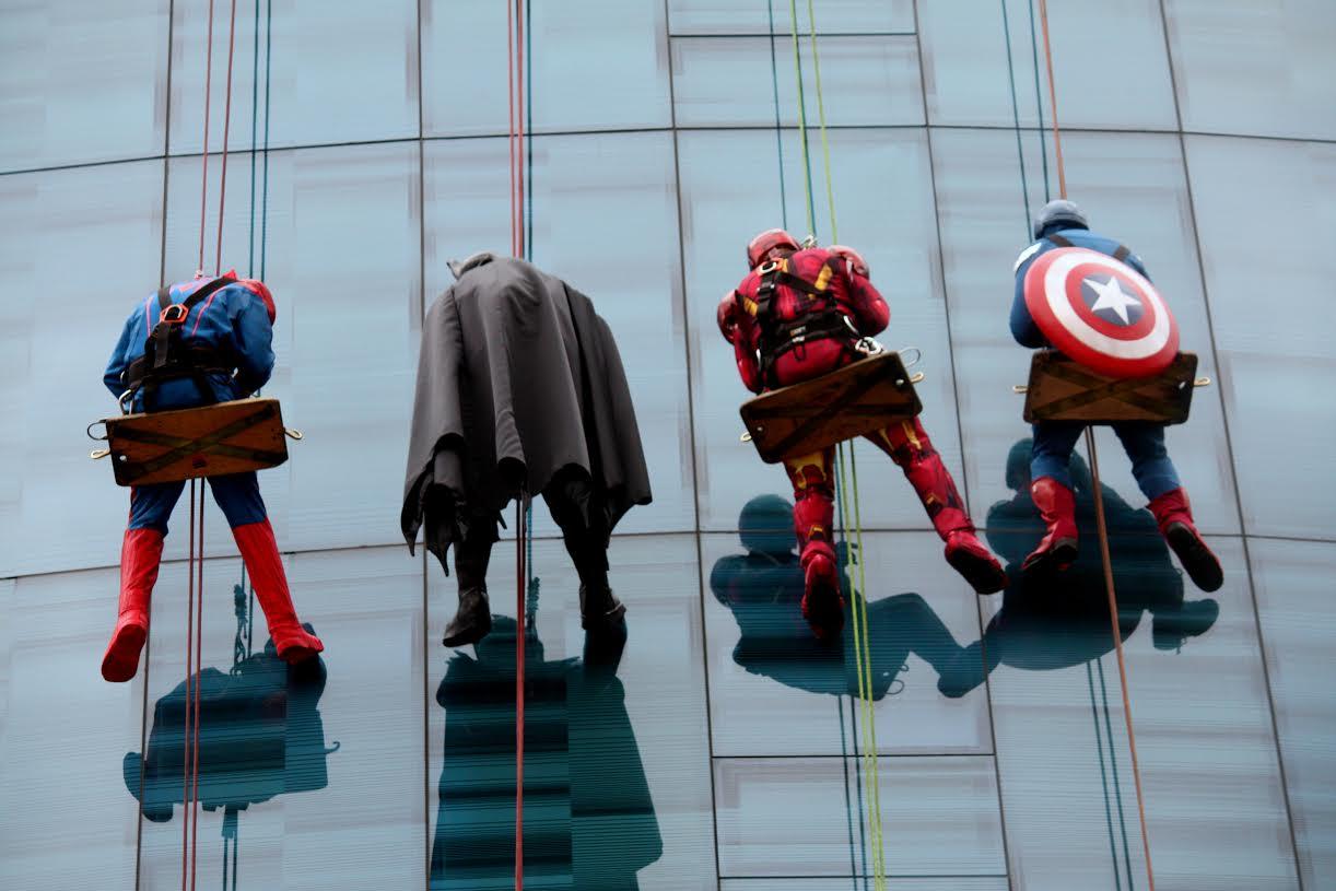 Superheroes waving at kids at the Helen Devos Children's Hospital Halloween party