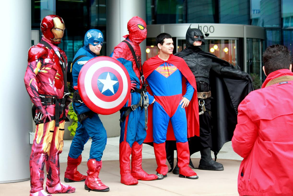 Superheroes pose for a photo op at the halloween party.