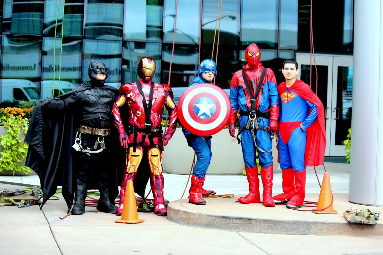 Window cleaners dressed as Batman, Ironman, Captain America, Spiderman, and Superman